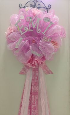 Baby girl deco mesh wreath. It can be used as baby shower decoration , to hang on a hospital door , and to decorate baby nursery.