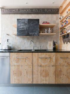 shallow shelves, knife board, sliding chalkboard, soapstone, pale cabinets, toe kick dark like floor