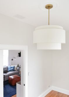 Tiered pendant. Drum pendant. Tiered drum pendant. White pendant. Linen shade. Adjustable lighting. Statement lighting. White room. Sophisticated style. Portland made lighting. Rejuvenation lighting.