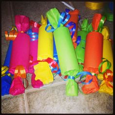 Candies for my candy themed classroom. Simple: toilet paper roll, tissue paper, curling ribbon.