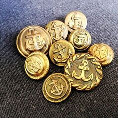 Fabulous collection of 9 vintage sailors buttons. Rescued Navy supply.