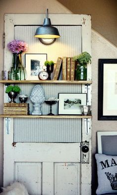 An upholstered backboard and industrial light fixture give this simple idea for extra shelving a stylish country look. Get the tutorial at Bulb to Blossom.