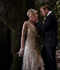 After getting Daisy to one of his parties, Gatsby tells Daisy that she must tell Tom that she never loved him.  Gatsby tells her that Tom needs to know that she loves him and not Tom.