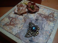 6. mini wooden box, decorated with scrapbook paper, acrylic paints, fabric and metal ornaments :)