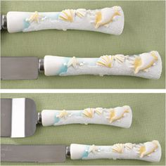 """Seaside Jewels Cake Serving Set - WeddingDepot.com - 030-32306-NI Perfect for an outdoor wedding or an event with a beach theme.  Light blue resin handles are carved with a realistic seashell design and white sparkling sand.  With stainless steel blades the knife measures 12.5"""" and the server measures 11""""."""