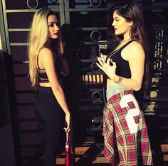 Pia Mia and Kylie Jenner. Love love love the red lipstick  matching plaid sweater on Kylie.