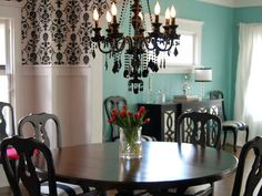 A little Tiffany Blue in the dining room with black - not to mention the chandelier