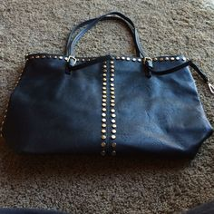Lowest price Tote black tote Gold studs. Faux leather black tote. Inside has many pockets and storage. Worn a few times. Bags Totes