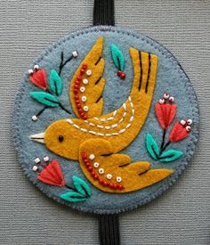 folk art european folk lore bird motif applique felt design for all sorts of art and craft mmmcrafts: felt bookmark for Robyn beautiful embroidery Embroidery Designs, Felt Embroidery, Felt Applique, Simple Embroidery, Embroidery Stitches, Machine Embroidery, Felt Diy, Felt Crafts, Fabric Crafts