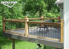 Deck with metal and wood posts and rails. I can totally see this off of my MBR! (With stairs to access a deck down below) Wooden Pool Deck, Metal Deck, Metal Balusters, Deck Railings, Railing Ideas, Outdoor Spaces, Outdoor Decor, Outdoor Living, Deck Pictures