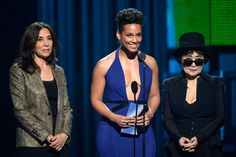 Olivia Harrison, Alicia Keys and Yoko Ono onstage on the 56th Annual GRAMMY Awards on Jan. 26 in Los Angeles