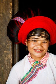 Vietnam   Portrait of a White H'mong hill tribe woman with distinctive big hair and traditional clothing, located in small village near to Sin Ho    © Kimberley Coole
