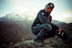Lupe Fiasco stops to rest during MTV's Summit on the Summit Kilimanjaro charity trek. Thomson Safaris was the official outfitter. Photographer: Michael Muller