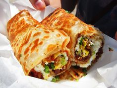 Chinese sausage and egg scallion pancake roll                                                                                                                                                                                 More