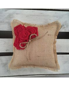 This natural burlap ring bearer pillow is detailed with four small red rosettes and complete with jute twine for the rings. Perfect addition to your wedding ceremony! #burlap #wedding