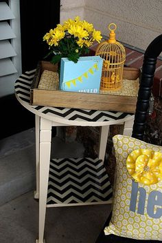 I decided to redo a little garage-sale table that sits on my front porch. The porch is covered, but over the winter all of the paint had peeled off and it was in sad shape.