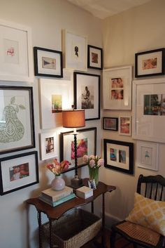 I never believe a mix of black & white frames will actually look OK...(Houzz tip--hang large groupings with horizontal center at eye-level).