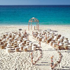 """Why We Love It: We love this whimsical set-up for a beach wedding ceremony!Why You Love It:""""I love the winding aisle, and the altar area and…"""