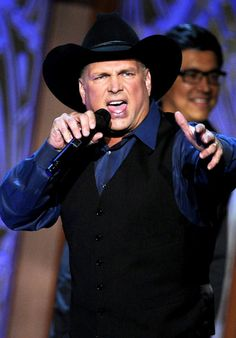 Garth Brooks his songs his voice his humor.He calms my soul then in a flash he has me kicked up my heels. What a rush! I love this man.