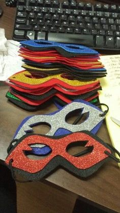 Super hero themed masks! So easy to make! Glitter foam on felt. Cute and comfortable!