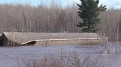 Covered bridge floats away April 16, 2014