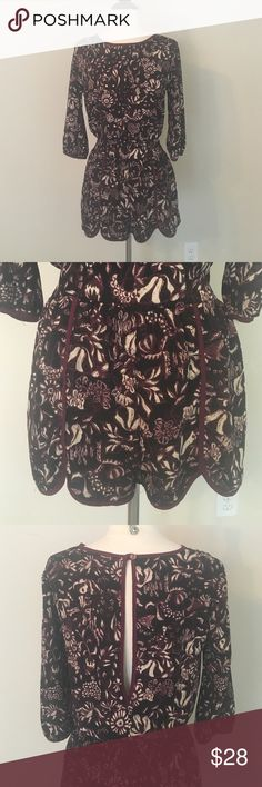 Floral Romper in *PERFECT* Condition Floral black& burgundy Romper with Open- Slit Back and playful hem around legs. 3/4 sleeves, elastic waistband in back, button closure in back, burgundy hem along neck, sleeves, and front of shorts. Worn ONCE in amazing condition. Brand: Final Touch from local boutique. Fabric: 100% polyester. Perfect for Fall with some knee high boots! Other
