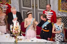 Princess Mary toasting along with Hereditary Duke Of Luxemburg and Queen Letizia of Spain.  I noticed the woman to Mary's right is wearing a gown very similar to Mary's.  I bet Mary didn't like that!!!!  This get together was the 75th birthday of Queen Margareth of Denmark.