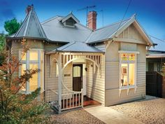 Photo of a corrugated iron edwardian house exterior with bay windows & landscaped garden - House Facade photo Browse hundreds of images of edwardian house exteriors & photos of corrugated iron in facade designs.