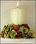 photo of woven flax flowers around a candle