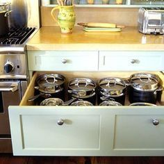 """Deep Drawers:  It makes a lot of sense to place a deep drawer right beside the kitchen range for easy access to large cooking pots and pans. Drawers may be limited in their size by the cabinet that houses them, but drawers that probe the depths have marvelous utility. Consider this arrangement when planning your next kitchen upgrade"""