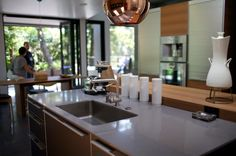 tambour doors....appliance storage....Dwell on Design 2013 Exclusive House Tour: Kim Residence in architecture  Category