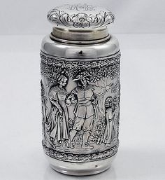 "German 800 Silver Floral Tea Caddy with chased high relief floral decoration in a arts and crafts style. The cap pulls off the octagonal base which is decorated on all eight sides. Height: 4 3/4""."