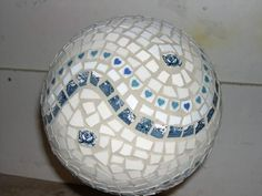 I have 2 balls in the garage waiting to become masterpieces in our garden. Mosaic Bowling Ball