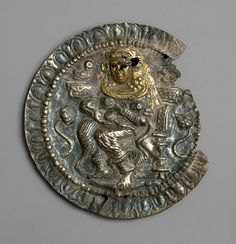 *Roundel with the Buddhist goddess Hariti, ca. 1st century a.d. Pakistan, ancient region of Gandhara. Silver, gold foil