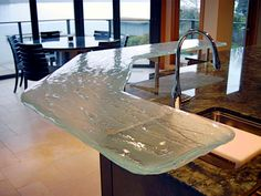 This glass bar is a good example of how the details make a difference in design. Recycled Glass Countertops, Slumped Glass, Cast Glass, Glass Table, New Homes, Dining Table, Architecture, Wall, Furniture