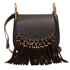 Chloè's Hudson bag has been just one style in a long line of must-have accessories from the French brand that we've had our eye on recently. Spotted on the arms of many a blogger in recent seasons, its saddle shape and cool gold-toned hardware has made it a winner amongst the style set .