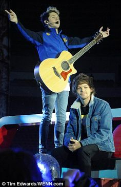 Raise your hands: Niall and Louis throw themselves into another track as the gig at Sunder...