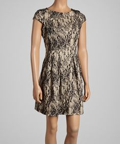 Delicate lace defines the silhouette of this decadent dress, while classic black and a cap-sleeve design add timelessness and style. It's a look sure to turn heads at any soiree.