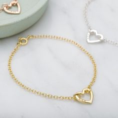 Our beautiful little Personalised Mini Heart Bracelet makes the perfect gift. Handcrafted from fine sterling silver, with the option for 9ct rose or 9ct yellow gold plating, the bracelet can be personalised with up to 6 characters for a truly special touch. Popular personalisations include names and special dates, alternately if you would prefer your bracelet without personalisation please leave the text box blank. The Personalised Mini Heart Bracelet makes a great gift for birthdays…