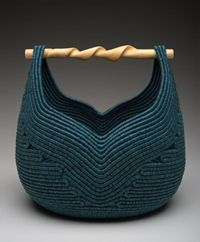 Lauren Briston. Would love to put my yarns in this basket!