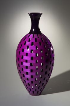 "Joel Hunnicutt - Hollow segmented turned vessel of dyed maple finished with high-gloss lacquer for a smooth, glass-like surface. 24"" H x 10"" diameter"