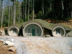 A Monolithic Dome Hobbit Home — The front entrance of this earth-bermed…