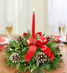 Berry Merry Christmas Centerpiece - Medium. From hanging stockings to making popcorn garlands, Christmas is all about celebrating traditions with friends and family. Create a new, lasting tradition of your own with our fragrant evergreen centerpiece arrangement. Hand-decorated with pinecones, looped red ribbon and a festive red taper candle, it's sure to be the talk of the table this season. Fresh centerpiece arrangement of assorted Christmas greens including noble fir, cedar and holly…