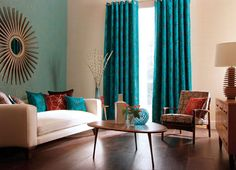 I love the lift that the aqua gives the mid century furniture, and adore the long window treatment..