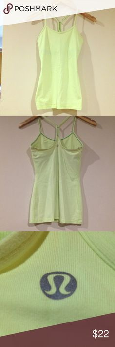 Lululemon yellow power Y tank Lululemon power Y tank in yellow ( slight lime green hue). Only worn a few times. Built in bra for support.  Good condition. lululemon athletica Tops Tank Tops