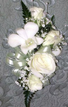 #corsage, featuring tea roses and dendrobium orchids with crystal sprays