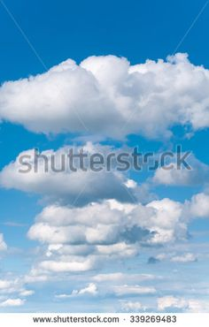 White cloudscape against azure sky in upright format - stock photo