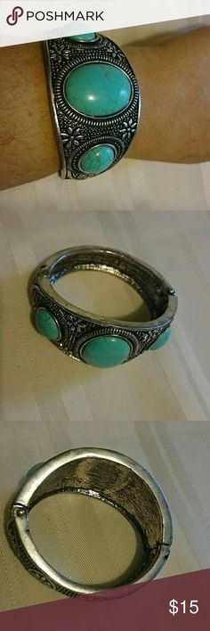 "*HP* Three Stone Cuff Boho Bracelet *HP 6/7* Heavy imitation turquoise bracelet has three stones. Hinged opening. 2 1/2"" wide on top, 1/2"" on bottom. Nice and sturdy. Jewelry Bracelets"