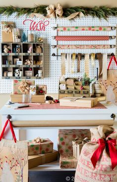 Create a wrapping station that will rival Santa's workshop! Organize yours with scissors, tape, twine, ribbon and wrapping paper.