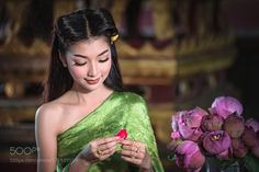 Asian girls in traditional national dress by Pitakchatr